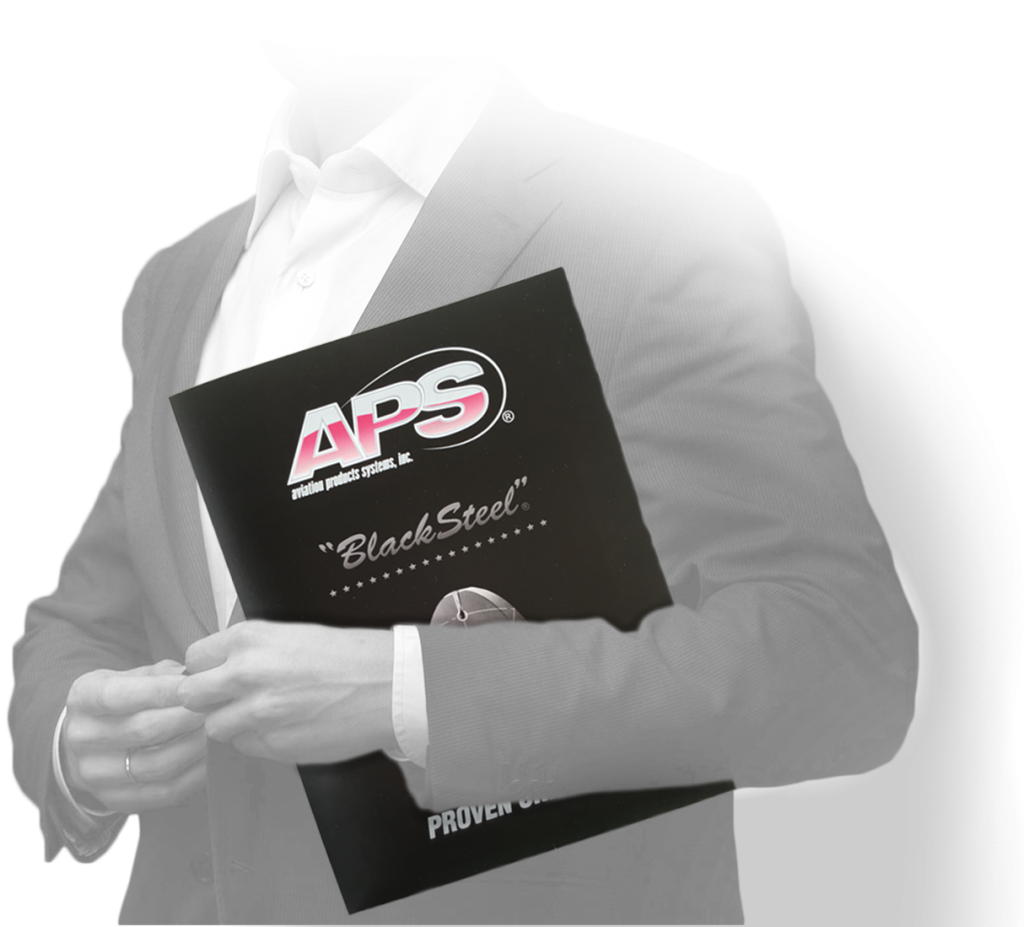 Image of a business person holding the pocket folder that Andrew Lee Smith designed for client Aviation Products Systems